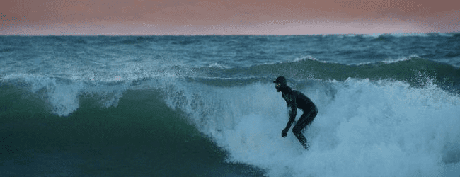 Area surfer finds his passion with Lake Michigan's wind, water and waves [VIDEO]