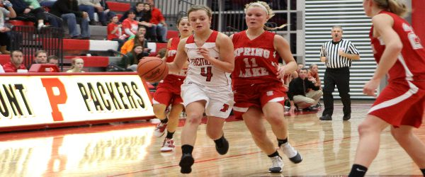 Claire Abendroth tough down the stretch as Fremont slips past Spring Lake in Lakes 8 girls basketball game