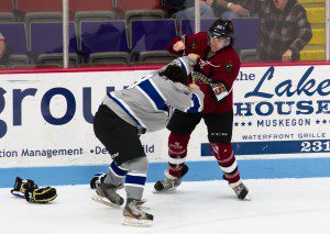 Muskegon Lumberjack Cameron Darcy, right, unleashes a right hand to the head of Fargo's Gabe Guertler during a second-period fight on Saturday night. Photo/Ellen DeLuca