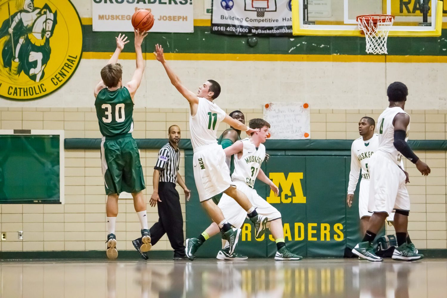 Western Michigan Christian posts key road victory over Muskegon Catholic in boys basketball action