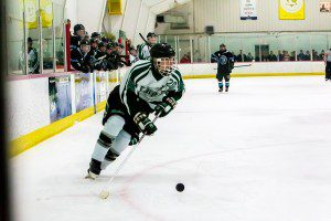 Reeths-Puffer's Josh Smith skates down the right wing with the puck in overtime on Sunday. Seconds later, Smith found Kyle Kendra for the game-winning goal. Photo/Tim Reilly.
