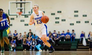Western Michigan Christian senior Julie Merz drives to the hoop during Friday night's game against Muskegon Catholic. Photo/Tim Reilly.