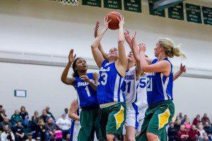 Muskegon Catholic's Kendall Wickstrom pulls down a rebound. Photo/Tim Reilly