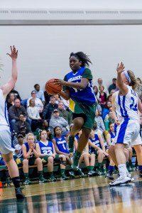 Muskegon Catholic's Toya Briggs jumps through the Warriors' defense.Photo/Tim Reilly