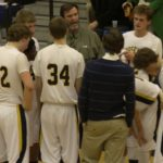 Jeff Cooke talks to his North Muskegon players during a timeout. Cooke was coach of the Norse for 18 years. Photo/Tim Reilly