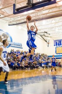 Montague's Luke VanBoxel soared through the air fortwo of his 18 points during last season's win over Oakridge. Photo/Tim Reilly