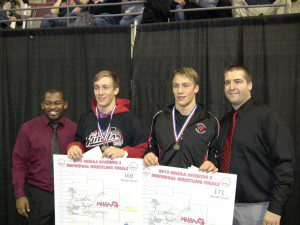 Steven (160) and Joe Sika stand with heach coach Cliff Sandee (right) and assistant coach Jason Johnson after the twins won their state championship matches back-to-back in the 160 and 171 weight classes.