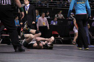 Chase Siersema reacts after falling just short of the Div. 4 135 pound state championship. Photo/Joseph Van Harken