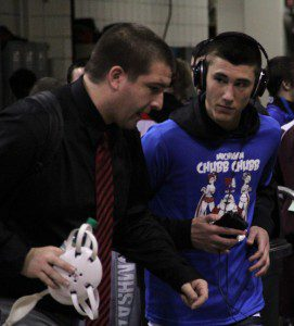 Cliff Sandee talks with Zack Cooper moments before Cooper's state championship match. Photo/Joseph Van Harken