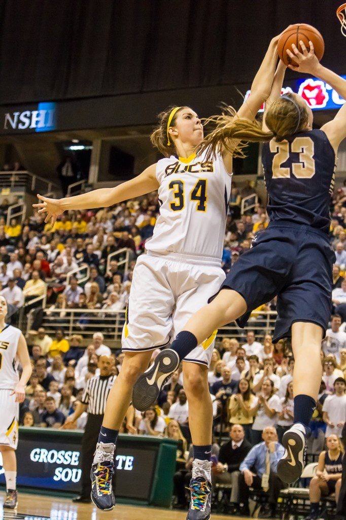 Abby Cole shows off her shot-blocking talent back in her Grand Haven High School days.