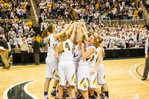 Grand Haven celebrates after winning the Division 1 basketball state championship