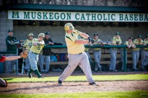 Mickey Reilly puts the game out of reach with a two-run pinch hit single for MCC. Photo/Tim Reilly