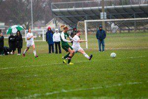Jessica Lad scores her second goal as WMC's Alli Langeland defends. Photo/Tim Reilly