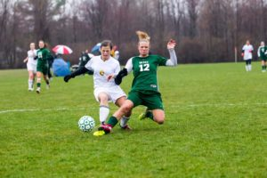 WMC's Allli Langeland fights the ball away from Natalie Bertolone. Photo/Tim Reilly