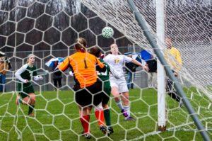 Jessica Ladd scores her second goal on WMC goalie Lindsay Johnson.