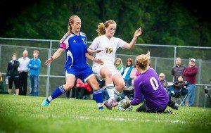 Fruitport Calvary goalie Hayley Mohr stops an attacking Molly Conroy. PHOTO/Tim Reilly
