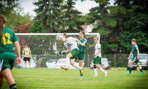 WMC's Alexys Riksen blocks a Stephanie Zorn kick. PHOTO/Tim Reilly