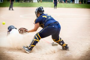 North Muskegon catcher Maddison Nelson hovers over the plate in a throw home during Saturday's div. 4 regional final softball matchup against Gobles. PHOTO/Tim Reilly