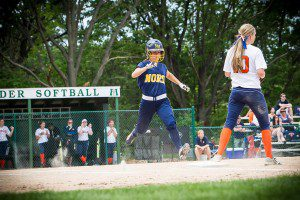 North Muskegon's Jennifer Vanderlinde reaches base during div. 4 softball action. PHOTO/Tim Reilly