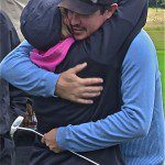 Mouw hugs girlfriend Caitlyn Gledhill after winning the Henderson championship.