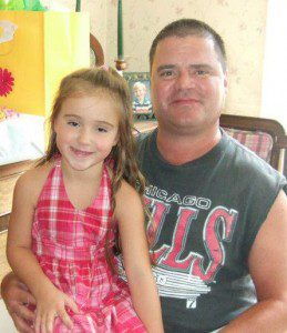 Duplissis sits with his daughter Olivia in June of 2012.