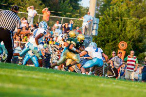 Nick Holt caps off the MCC drive with an 11-yard touchdown run. PHOTO/Tim Reilly
