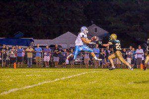Logan Smith catches a 29-yard  Tyree Jackson pass in the Mona Shores win. PHOTO/Tim Reilly