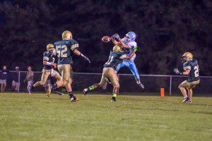 #11 MCC breaks up the pass allowing Blake Sanford for the interception. Photo/Tim Reilly
