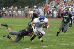Dom Greenawalt gets past GR West Catholic defense. Photo/Jeff Peterson