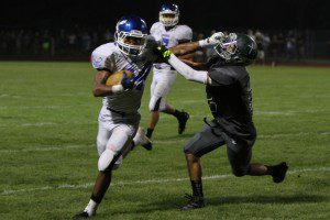 Jerick Wambaugh pushes for room against Grand Rapids West Catholic. Photo/Jeff Peterson
