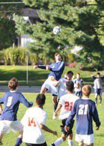 Sailor Jonah Shafer elevates for a header Wednesday versus Grand Rapids Union. The Sailors' loss to the Red Hawks makes their first conference loss since 2011. (Photo by Eric Sturr)