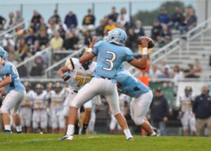 Mona Shores junior Tyree Jackson drops back to throw a pass in Sailor action against Grand Haven. Photo/Eric Stirr