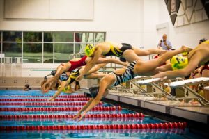 Swimmers from Spring Lake and Muskegon Catholic Central/North Muskegon Co-op enter the pool Thursday night in a meet between the two teams. (Photo by Tim Riley)