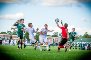 WMC goalie Christian Rogers battles for the ball surrounded by a host of Crusaders