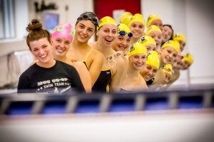 Members of the Muskegon Catholic Central/North Muskegon Co-op squad line up for a team shot Thursday during their meet against Spring Lake.