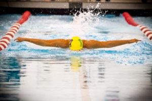 Muskegon Catholic/North Muskegon Co-op swimmer Kara Komarek competes in the butterfly event Thursday versus Spring Lake.