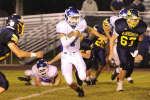 Oakridge quarterback Austin Wright breaks to the second level Friday night versus North Muskegon. (Photo by Jeff Peterson)