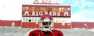 Muskegon's John Hall is one of the few Big Reds to handle both offensive and defensive duties. (Photo by Mark Lewis)
