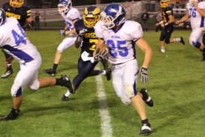 Oakridge senior running back Dan Shoop breaks upfield in his squad's victory Friday night against North Muskegon. (Photo by Jeff Peterson)