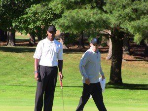 Byron Scott consuls with Scott Volkman during Saturday's Celebrity Golf outing at Muskegon Country Club.
