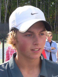 Mona Shores' Sam Kling talks after his first-singles city championship. Photo/Jason Goorman