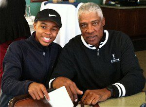 Devon Kitchen sits with Dr. J in the Muskegon Country Club.
