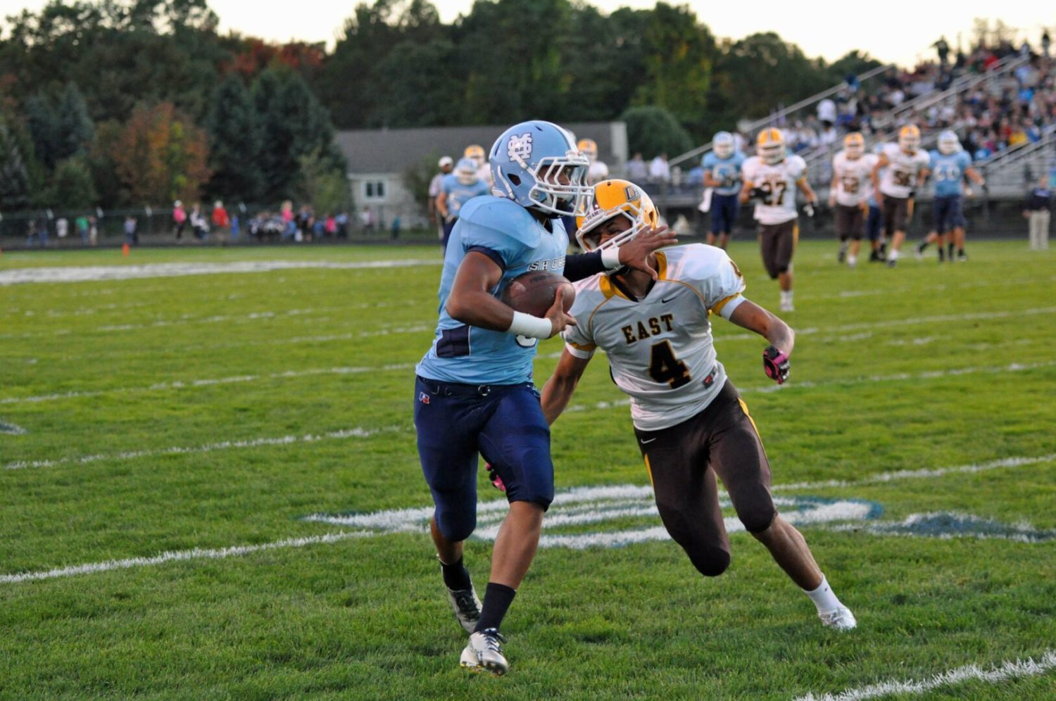 A monkey off their backs: Mona Shores nails down its first playoff berth with a 47-26 thumping of Zeeland East