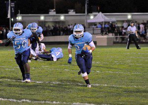 Mona Shores junior Noah Dykstra with  the interception and senior Malik Taylor leading for support. Photo/Eric Sturr