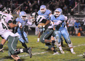 Reeths-Puffer senior Julian Munday's running proved too much for the Mona Shores defense. Photo/Eric Sturr