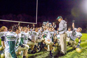 First-year Muskegon Catholic Central head coach Steve Czerwon talks to his team following the Crusaders' 42-7 victory over Fruitport. Photo/Tim Riley