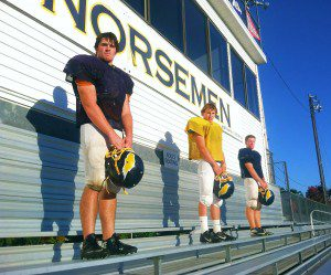 "North Muskegon linemen, from left Aidan Rhyndress, Ryan Gannon and Justin Fairfield, are what North Muskegon head coach Mike Belmonte calls ""the team's backbone."" Photo/Mark Lewis"