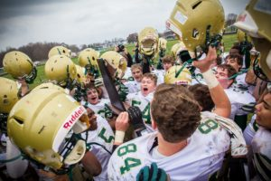 Muskegon Catholic celebrates with the regional title. Photo/Tim Reilly