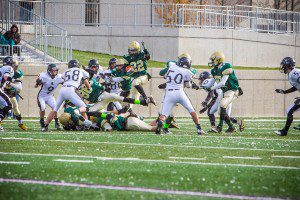Catholic junior Blake Sanford soars for extra yards on a kickoff return. Photo/Tim Reilly