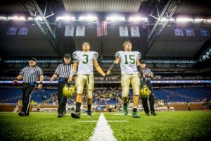 Muskegon Catholic Central captains Nick Holt, left, and Alex Lewandoski walk to the middle of Ford Feild for the opening toss. Photo/Tim Reilly